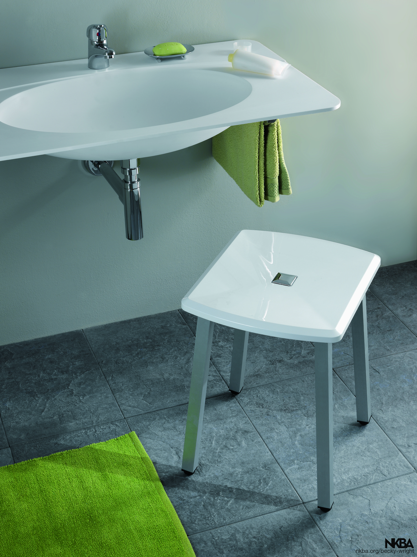 Sink with added arm space and stool - NKBA
