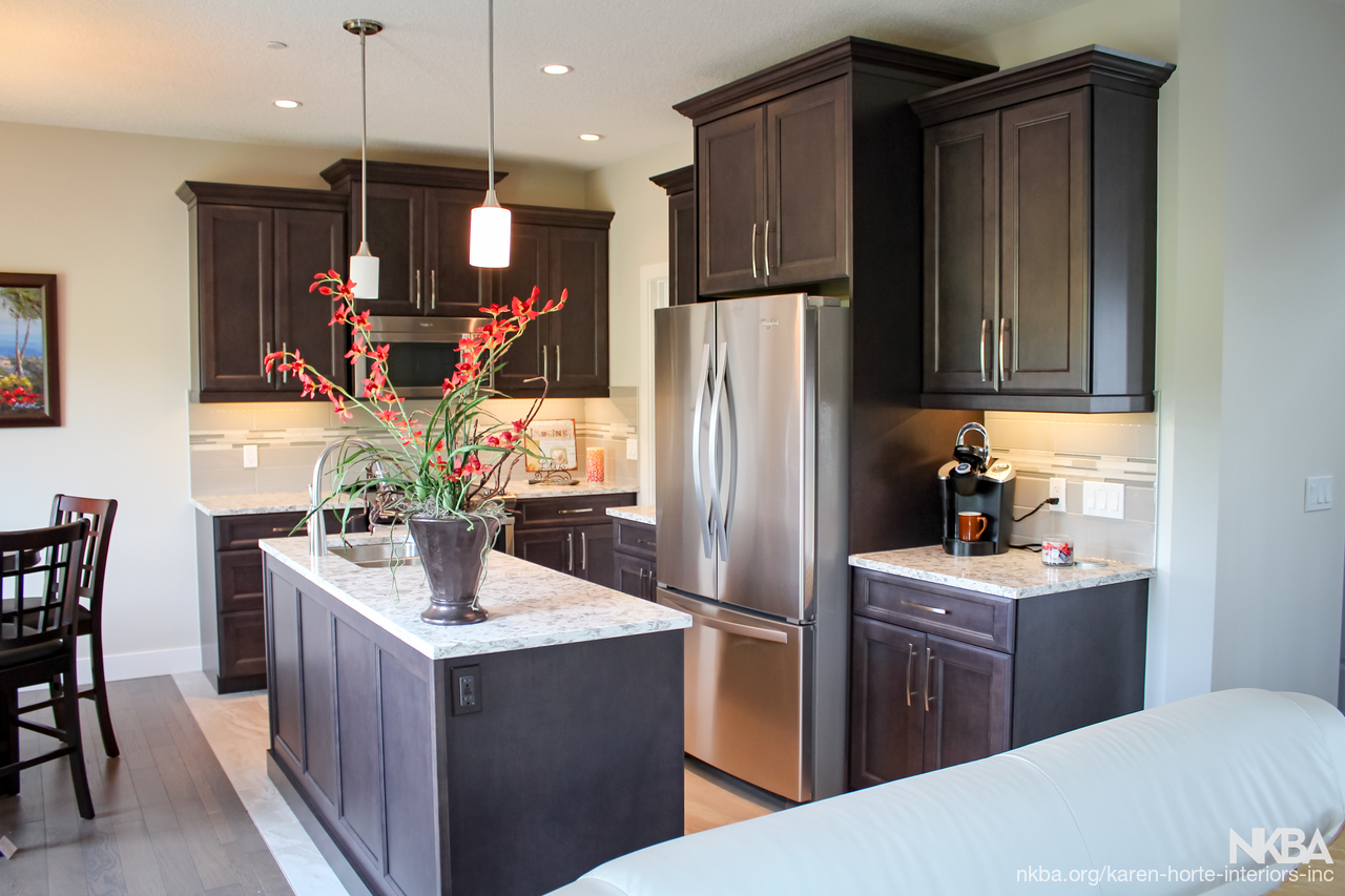 Stained Kitchen With Staggered Heights And Depths Nkba