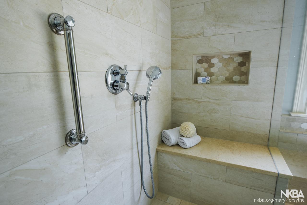 . Travertine porcelain tile in shower   NKBA