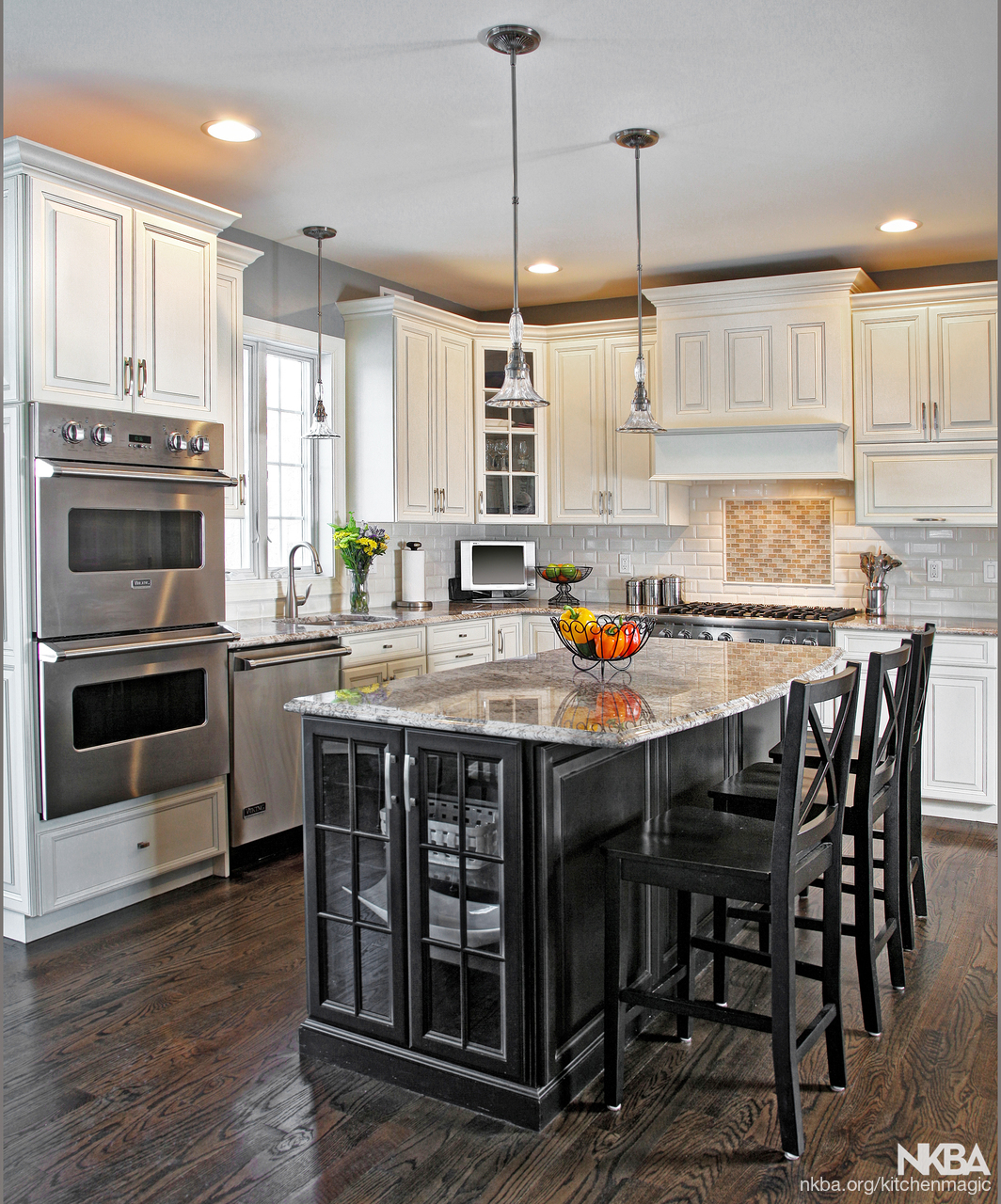 Ebony Black Island Surrounds By Antique White Cabinets Traditional Kitchen