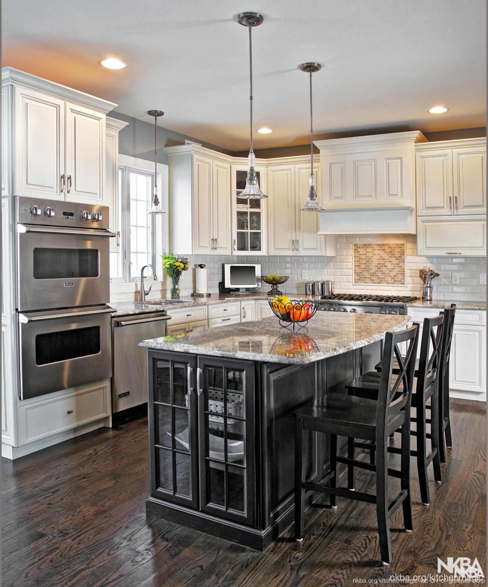 Antique White Kitchen: Ebony Black Island Surrounds By Antique White Cabinets